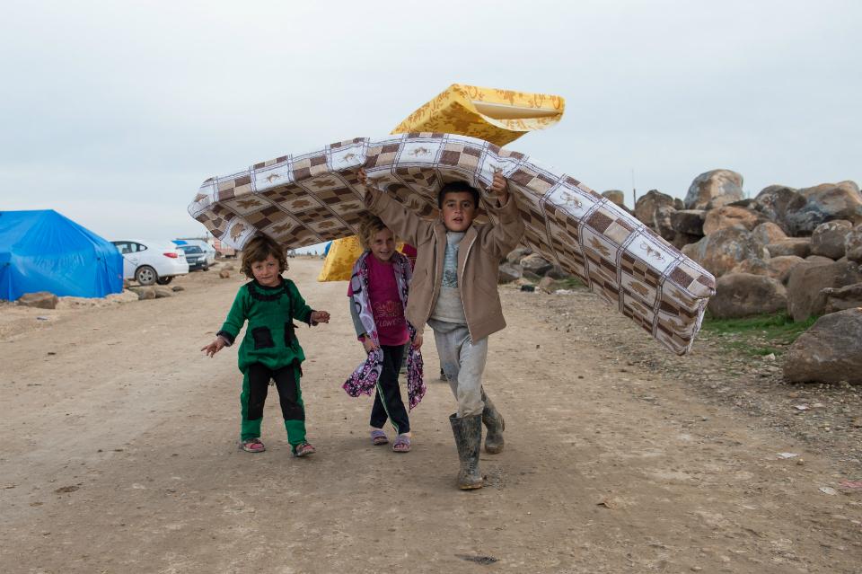 children-carrying-mattress